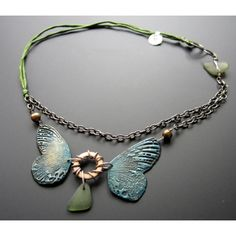 ooak handmade bronze wings by staci louise smith, genuine sea glass make up this asymmetrical necklace