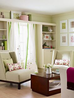 Fresh Living Room - This living room in a pink-and-green color scheme is kept subtle thanks to the monochromatic walls and sparing use of color. To dress up the room, ready-to-assemble cabinets were raised up; custom doors were added and topped with a bridge to make them look like a built-in masterpiece.