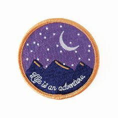 """Our Night Adventures patch can be ironed onto your back-pack or jean jacket. 2"""" embroidered twill patch. Iron-on. Made in USA. © Copyright 2016 August Ink"""