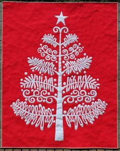 This is a large quilt - but perhaps I can make it smaller to hang during the holidays? Love the shape of this tree!