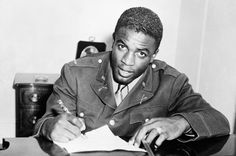 """06 Jul 42: Army Lieutenant John Roosevelt Robinson (baseball legend Jackie Robinson), one of the 761st """"Black Panther"""" Tank Battalion's few black officers, refuses orders to sit in the back of a military bus at Fort Hood, Texas. He is subsequently court martialed, but the charges will be dropped because the order is a violation of War Department policy prohibiting racial discrimination in recreational and transportation facilities on all Army posts."""