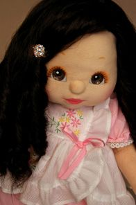 My child dolls. I am so sad they don't make these anymore! I had three of them when I was growing up - 2 girls and 1 boy. One of my dolls looked a lot like this pin. They are gorgeous dolls!