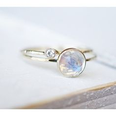 This beautiful Moonstone Diamond Ring Set in 14k Gold is an absolute stunner! A 6mm rose cut Rainbow Moonstone paired...