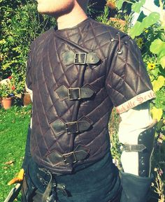 Made this gambeson for my husband to wear at a LARP. The cut is based on the armor of the 'Witcher' character Geralt from the PC games and the books. The inlay is made of cotton, the outside is mad...