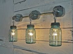 Lights made from junction boxes, conduit and mason jars.  Would be good on a covered porch.  Jars could also be painted with the glue and food coloring scheme if you don't have the antique ball jars with lead lids.