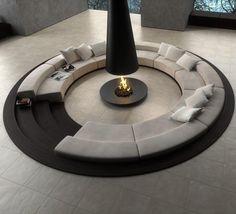 Living circular en denivel con chimenea moderna