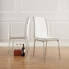 These simple modern dining chairs feature comfy vinyl seats and backs with contrasting trim. Chrome legs add elegance and stability. Each set includes two chairs. The slender, sophisticated design makes them excellent choices for smaller rooms.