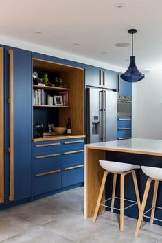 If your kitchen is in dire need of a refresh, the perfect place to start is with new cabinets that will instantly update your look. Here are 11 styles that will spice up your kitchen and give it a much-needed facelift. #hunkerhome #kitchen #kitchencabinets #kitchencabinetupdates #kitchencabinetideas Dark Wood Kitchen Cabinets, Dark Wood Kitchens, Blue Cabinets, New Cabinet, Family Kitchen, Kitchen Colors, Kitchen Ideas, Kitchen Storage, Ikea Kitchen