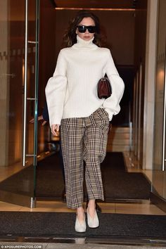 Chic: Proud parent Victoria Beckham ensured she turned heads as she left her hotel in New York on Thursday