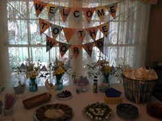 """This is a """"Welcome to the World"""" baby shower my friend and I gave for her daughter.  We made banners from an old Thomas guide."""