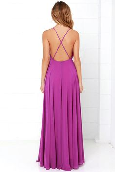 The Mythical Kind of Love Magenta Maxi Dress is simply irresistible in every single way! Lightweight Georgette forms a fitted bodice with princess seams and an apron neckline supported by adjustable spaghetti straps that crisscross atop a sultry open back. A billowing maxi skirt cascades from an elasticized waistline into an elegant finale, perfect for any special occasion! Hidden back zipper with clasp. As Seen On Solange of solange_marie_!