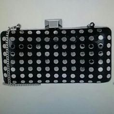 Milly Studded evening clutch Black snake stamped leather styled with a tuck away chain strap and silvertone flat studs. Milly Bags