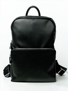 """Backpack by Wills - This practical yet stylish backpack by is perfect for work or travel. Made from soft yet durable pebble grain vegan leather, it has chunky metal hardware, and dark red, waterproof lining that makes a statement. It has a front, zip compartment, two interior compartments and padded shoulder straps for comfort. Fits up to a 14"""" laptop. 29cm W, 41cm H. Ethically made in Portugal. Vegan."""