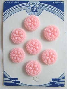 ButtonArtMuseum.com - Set 7 pink vintage carved buttons on original card