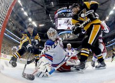 Gooooooooal!    Patric Hornqvist, left, of the Pittsburgh Penguins scores past Antti Raanta of the New York Rangers during game one of their Stanly Cup Playoffs matchup on April 13 in Pittsburgh.  -     © Justin K. Aller/Getty Images