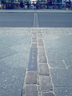 The path of Berlin Wall on the streets in Berlin, Germany.   Check out for more travel tips about Berlin!
