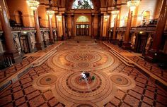 A cleaner prepares the rarely seen Minton tiled floor of St George's Hall in Liverpool. The exquisite floor which is usually covered for protection has been unveiled to allow the public a glimpse of the 30,000 hand made mosaic tiles