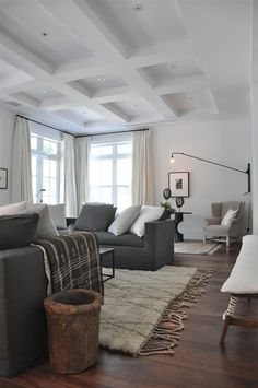 Have to do something with the ceiling in one of the rooms downstairs - needs a little touch** Grey and neutral sitting room with rustic touches, by briggs solomon More