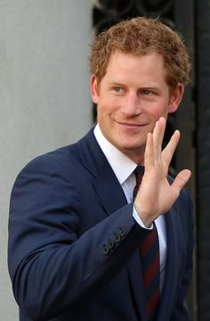 Prince Harry waves as he visits the La Moneda Presidential Palace where he met Chilean President Michelle Bachelet (not seen) on June 27, 2014 in Santiago, Chile.
