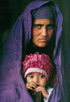 The Afghan Girl 18 years later. And she has a lovely daughter! • By Steve McCurry 2002