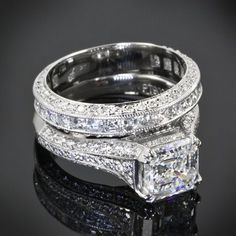 This platinum engagement ring is showcasing a 1.94 G VS1 Asscher set with 22 Asscher cut diamonds and 60 A Cut Above Melee diamonds. The matching diamond band is scattered A Cut Above Diamond melee. -