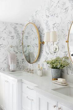 Mixing metals, chrome and gold bathroom, wallpaper bathroom, wall sconce between mirrors, double vanity
