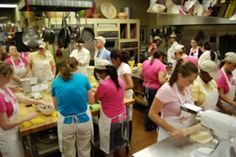 A huge group makes pasta from scratch - it's their teambuilding at AndyFood.