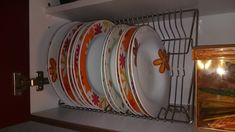 Plate organizer: It's easier in and out the kitchen cupboard - using IKEA dish racks