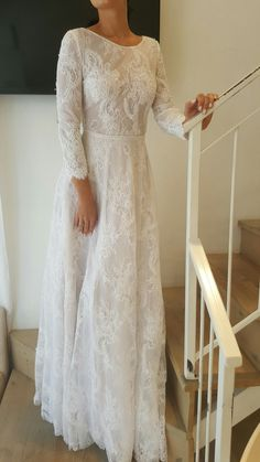 Beaded lace modest wedding gown with sleeves. Studio Levana