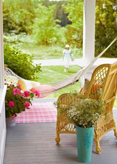 A Hammock, flowers and wicker are the perfect summer porch additions | Midwest Living