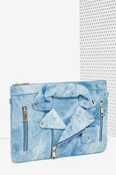 No mo moto FOMO. The Moto Mama Bag is made in acid wash denim and features moto jacket design at front with functional zip pockets, removable...