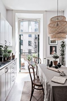 Bright Scandinavian dining space with a large pendant light.