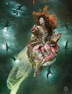 by zena holloway - i love the surreal quality of waters underneath the water surface backlit by orbs of light . . . magical!
