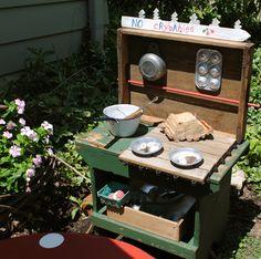such a cute idea - a mud pie kitchen!