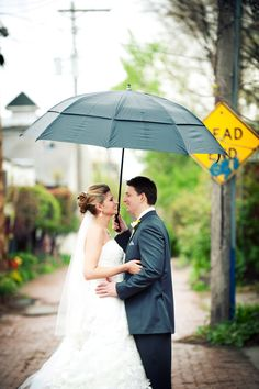 Making the best of a rainy wedding day! Photo by Troy #minnesota #wedding #photography