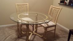 """Glass kitchen table with 2 chairs.  42"""" across, 28.5"""" high. Perfect for  1-2 people, or for breakfast nook."""