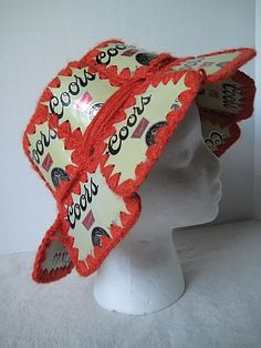 Crochet floppy brim hat with individual beer can flaps.  I love this!  :)