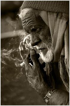 He was just an old man on the street, smoke in his lungs, music at his feet, his eyes staring at everyone who walked by him.