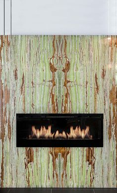 Backlit green bamboo onyx fireplace.