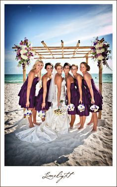 Lido Beach Resort, bride and bridesmaids, purple dresses, blue sky, beach, Wedding, Limelight Photography www.stepintothelimelight.com