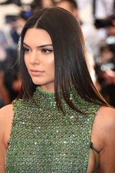 Kendall Jenner rocks her sleek brown locks on the Met Gala red carpet