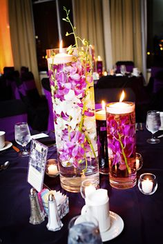 Submerged Hot Pink Orchid Centerpieces, certain venues won't allow candles...we could always change it to an artificial light source.