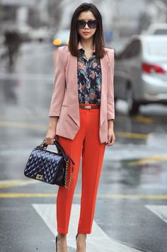 With floral shirt, pale pink jacket and bag