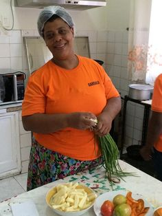 Zinha Esculudes's sister, Dona Alisa, who works at Zinha's restaurant, Gargalo Restaurant, Restaurants, Dining Room