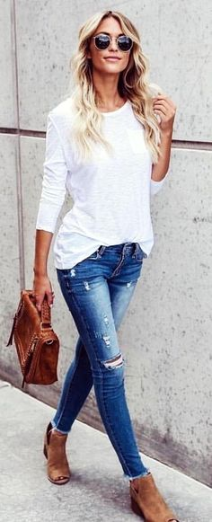 #fall #outfits  women's white long-sleeved crew-neck shirt and distressed blue wash jeans