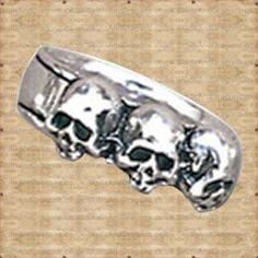 Caput Mortum Ring in Rings from Jewellery. Three deaths for the auspicious. Each caput mortem, or deaths head, representing one mortal life.