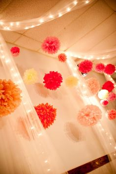 Love this look for a party/ wedding. Paper flowers, tulle and Christmas lights.