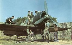 Re.2000 fighter being serviced by ground crew in Sicily (1941)