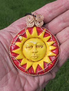 Clay Sun Face wrapped in Bronze wire. by johnchapman3 on Etsy