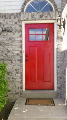 Door painted high gloss exterior Behr paint in Bijou Red